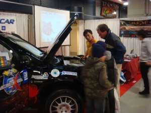 Carl Leung, UWAFT team member, talks with 2009 Canadian International Auto Show attendees