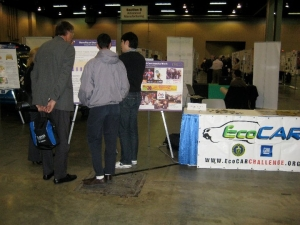 Georgia Tech EcoCAR team members talking to guests at the NSF Conference
